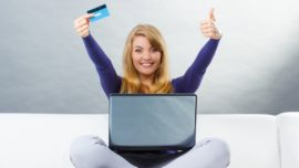 Online purchase, woman with credit card and laptop computer